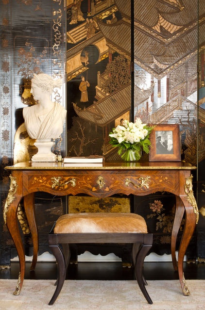 "French-style 19th-century marquetry desk. The drawers display a delicate flower and vine pattern, which is embellished with gold ormolu mounts. ""The coromandel Asian screen mixes beautifully with many styles for a global eclectic look. Note: Coco Chanel had over 30 similar coromandel screens in her fabulous Paris apartment"" Caroyn Williams, Antiques  Interiors, Atlanta."
