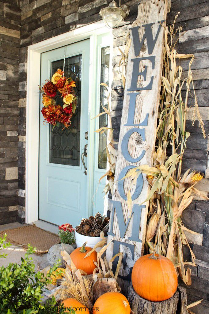 This fall, a rustic sign will add plenty of country charm while setting an inviting atmosphere for your guests. For additional decor, stack pumpkins on top of chopped logs to create height and dimension.