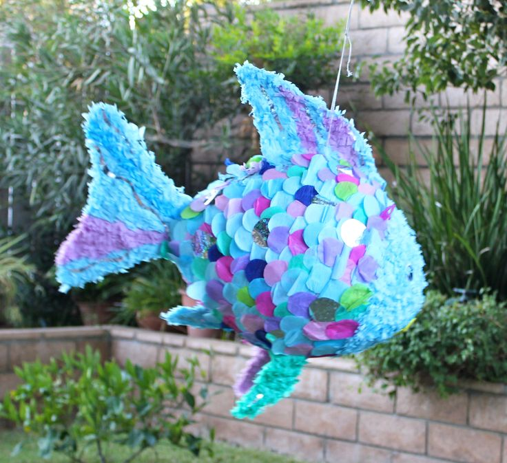 My Rainbow Fish pinata.  I was so sad to see it go.  We always have a great time making them.  My mom and I used a huge balloon and tons on tissue paper.  We had an under the sea themed party for my 3 year old.