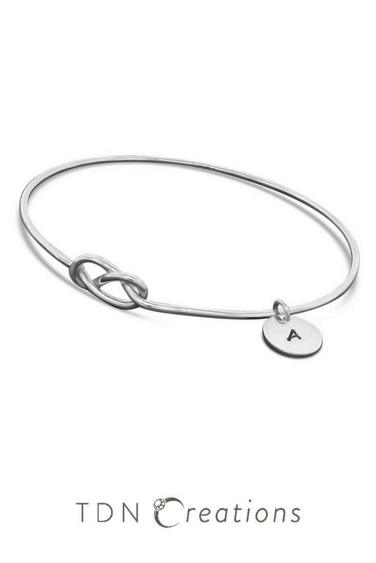 cca52f0b8060 Sterling silver figure 8 knot bangle bracelet personalized with hand stamped  tag