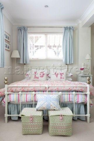 Keep walls and furniture white, bring colour in through fabric and ornaments, if you get bored bring another colour in without having to redecorate