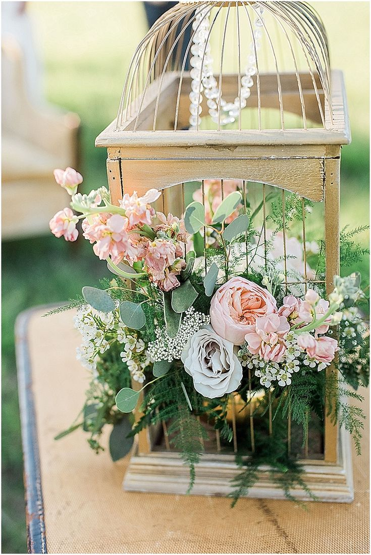leah adkins photography // little miss lovely floral design // gold birdcage filled with flowers centerpiece
