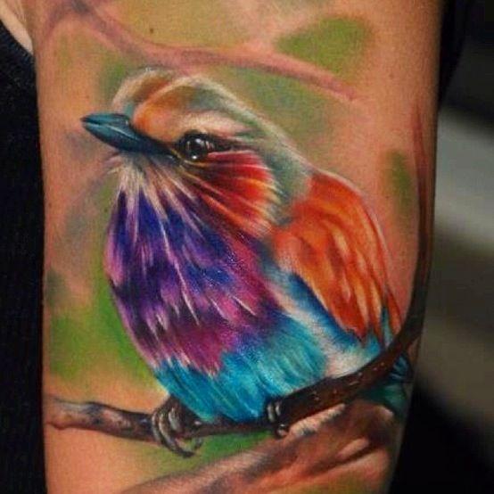 Watercolor bird tattoo on arm