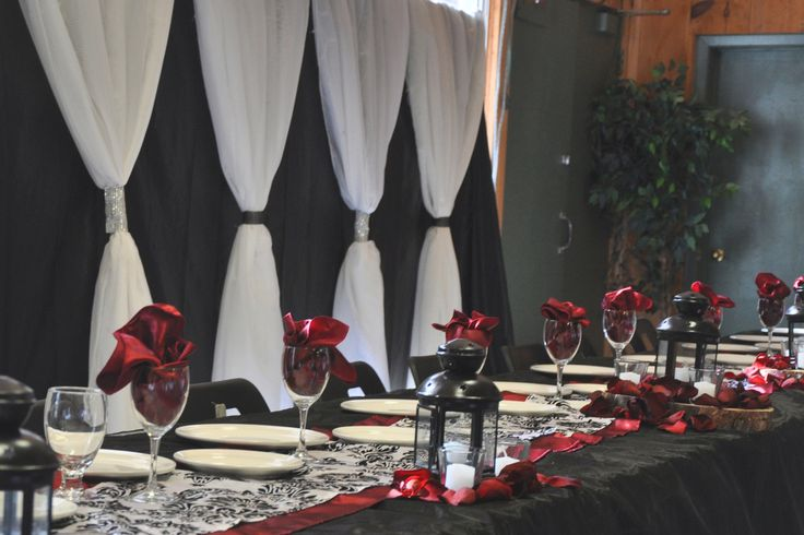 A beautifully decorated head table in MacDonald Lodge at Camp Kintail for a summer camp wedding
