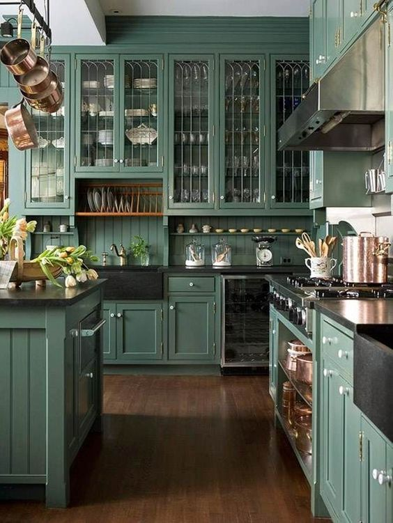 If you love Victorian interiors, you're bound to love this kitchen. With dark colors, beautiful glass paneling, and porcelain kitchenware, it's hard not to view this kitchen as a Victorian paradise.