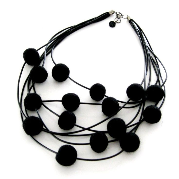 Halsband av gummi och ullbollar. Necklace, rubber and wool beads