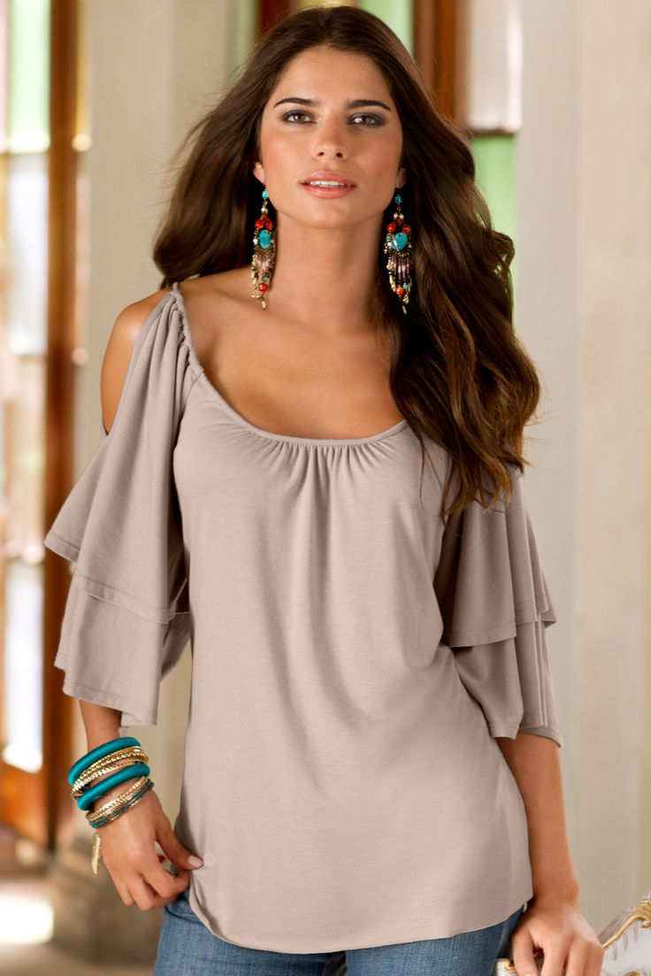 Knit top with cut-out shoulders on flutter sleeves.• Rayon/spandex.• USA/imported.• Hand wash.• XXS(0), XS(2-4), S(6-8), M(10-12), L(14-16), XL(18).• Taupe.• FIT NOTE: Oversized; loose and boxy. Follow the given size equivalents for the best fit. If in between sizes take the next smaller size.