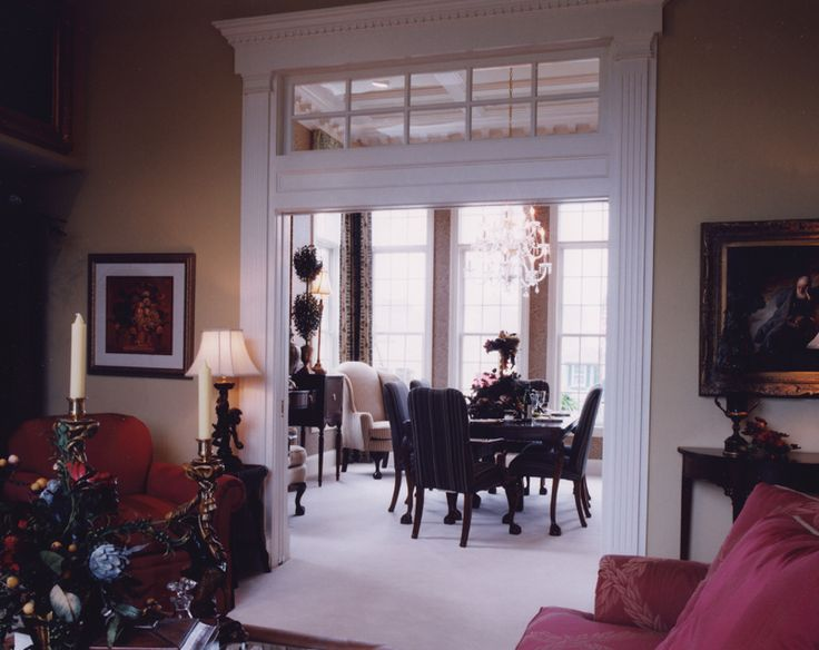 Stunning Formal Dining Room Entry With High Ceilings Trimwork And Transoms