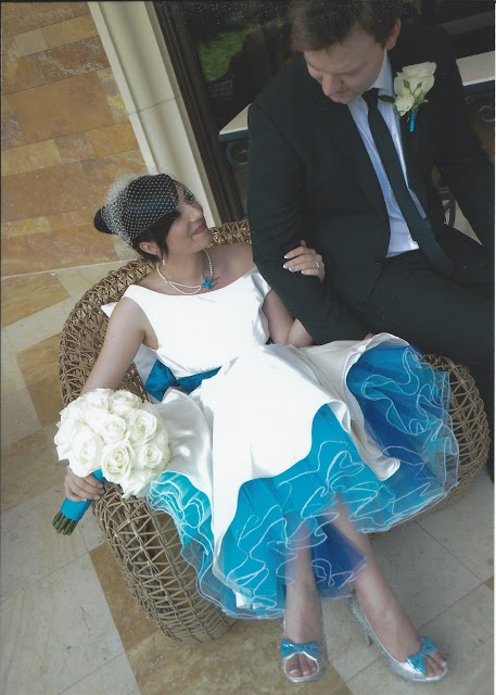 Cat wearing Holly by Lizzie Jayne Designs, 50s style wedding dress with multicoloured blue petticoat