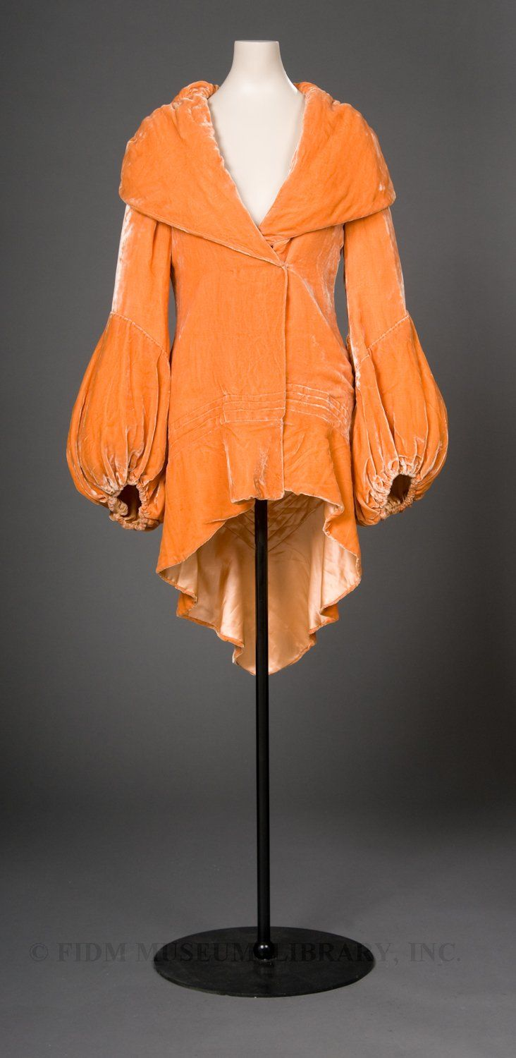 1930 velvet evening coat. Tangerine is supposed to be the big color for 2012 -- this is how to do it right. Also, interesting use of volume; collar balanced with balloon sleeves.