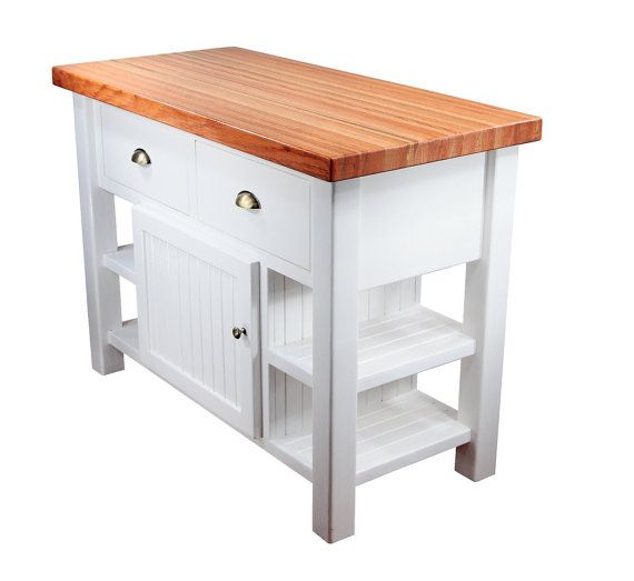 A gorgeous addition to any home, this kitchen island features an oak top, shelves, a cabinet, and two large drawers. This kitchen island has