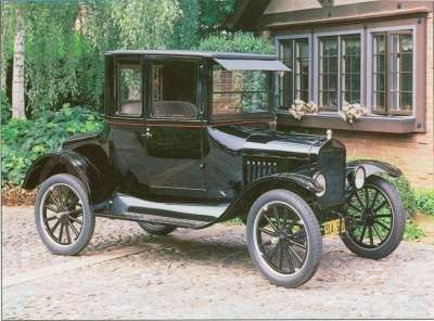 "During 1923, a new coupe design replaced the old  ""telephone booth"" style Model Ts. This 1925 Model T shows off the integral turtle-back deck and built­-in trunk introduced in 1923."