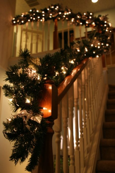 Beauitiful Christmas staircase with fairy lights, this reminds us of the Father of the Bride home! #Christmas #decorations