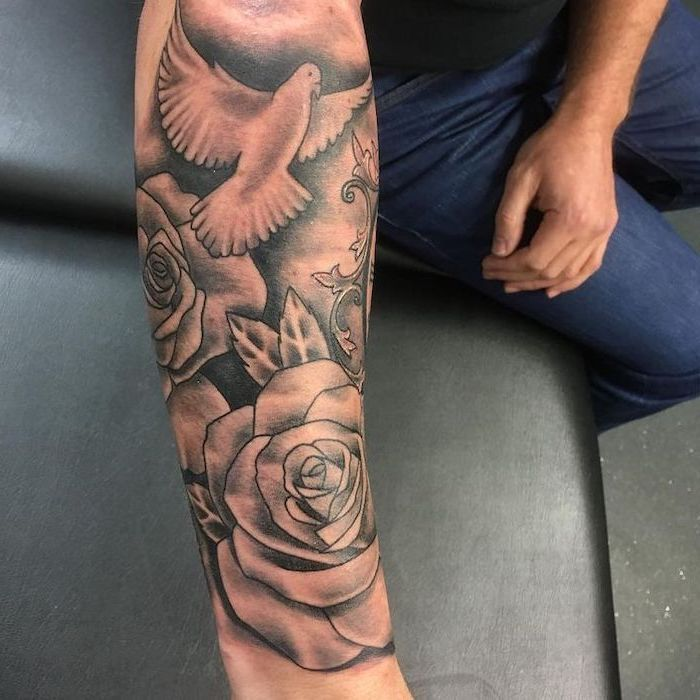 Flying Bird And Roses Forearm Tattoo Shoulder Tattoos For Men Black Leather Sofa Black Shirt And Jeans Idee Per Tatuaggi Tatuaggi Idee