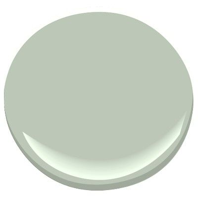 Benjamin Moore Antique Jade 465.  This color was GORGEOUS with my oak cabinets in the MBath.  Want to try a sample of it in my kitchen once I've stripped my wallpaper!