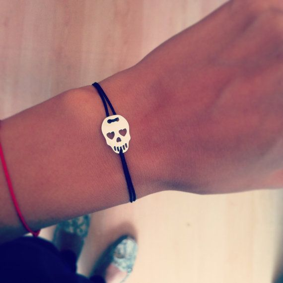 Little skull charm in sterling silver bracelet. Make a statement with a different charm bracelet. The bracelet is adjustable, made with silk string