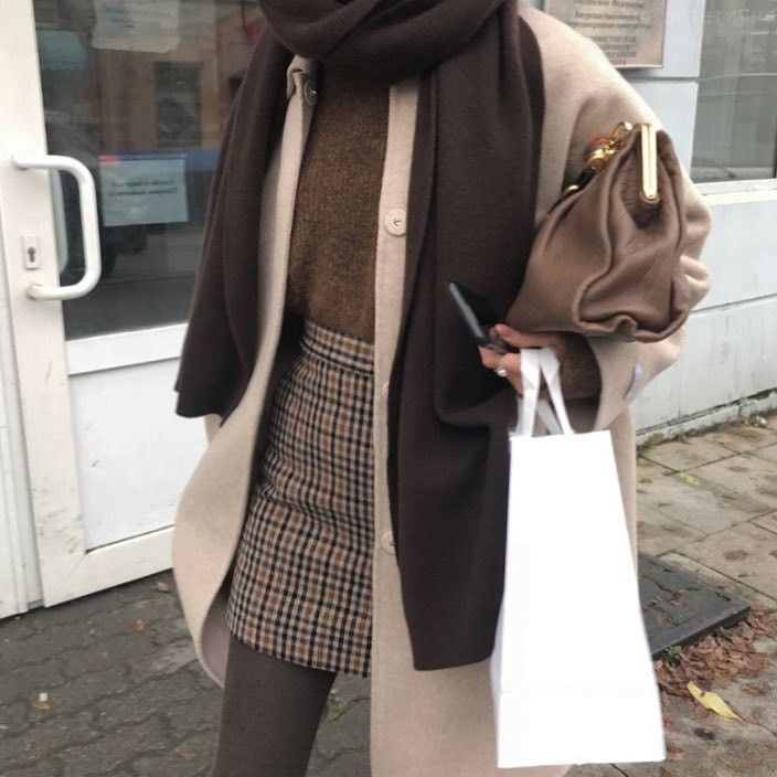 Casual browns and neutral tone outfit inspo for college | casual chic street style for winter or fall fashion | sweater and skirt with wintercoat and …