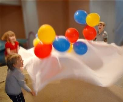 Bed Sheet Parachute ~ Bounce balloons, small, lightweight balls, or even rolled up socks on a bedsheet for simulating fun parachute game/exercises // Other fun, cheap ways to get kids moving (Ribbon limbo, balloon volleyball...)