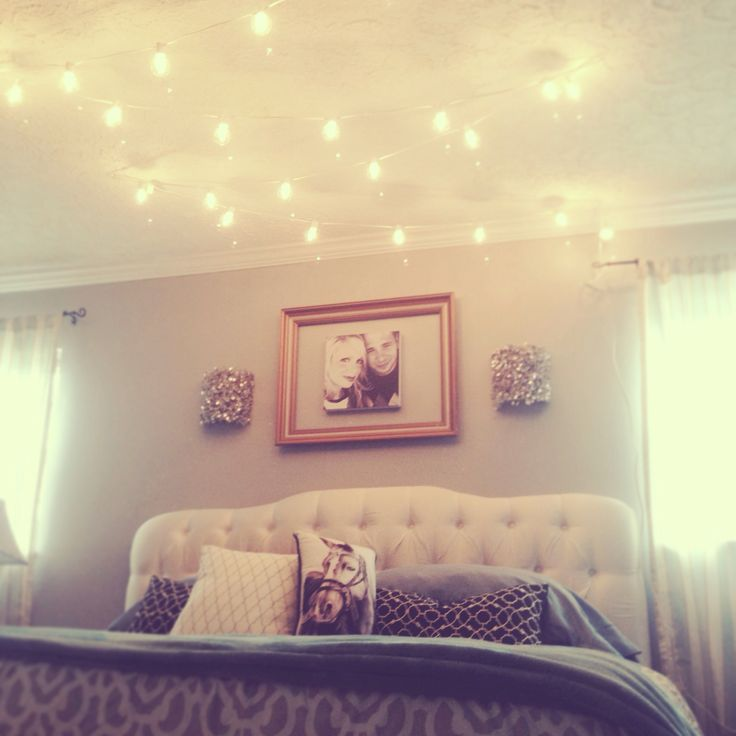 Break all the rules and hang globe string lights above the - String lights for bedroom ...