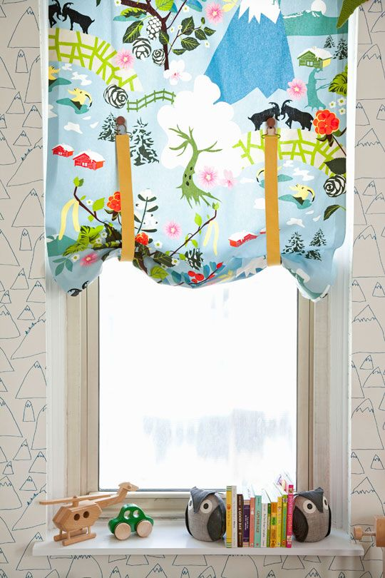 so simple and clever! the curtain panel can be raised by using suspenders and buttons.