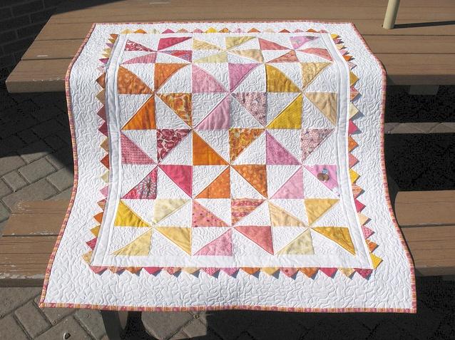 fresh modern quilts - tell tale threads - pinwheels quilt - orange, pink & yellow