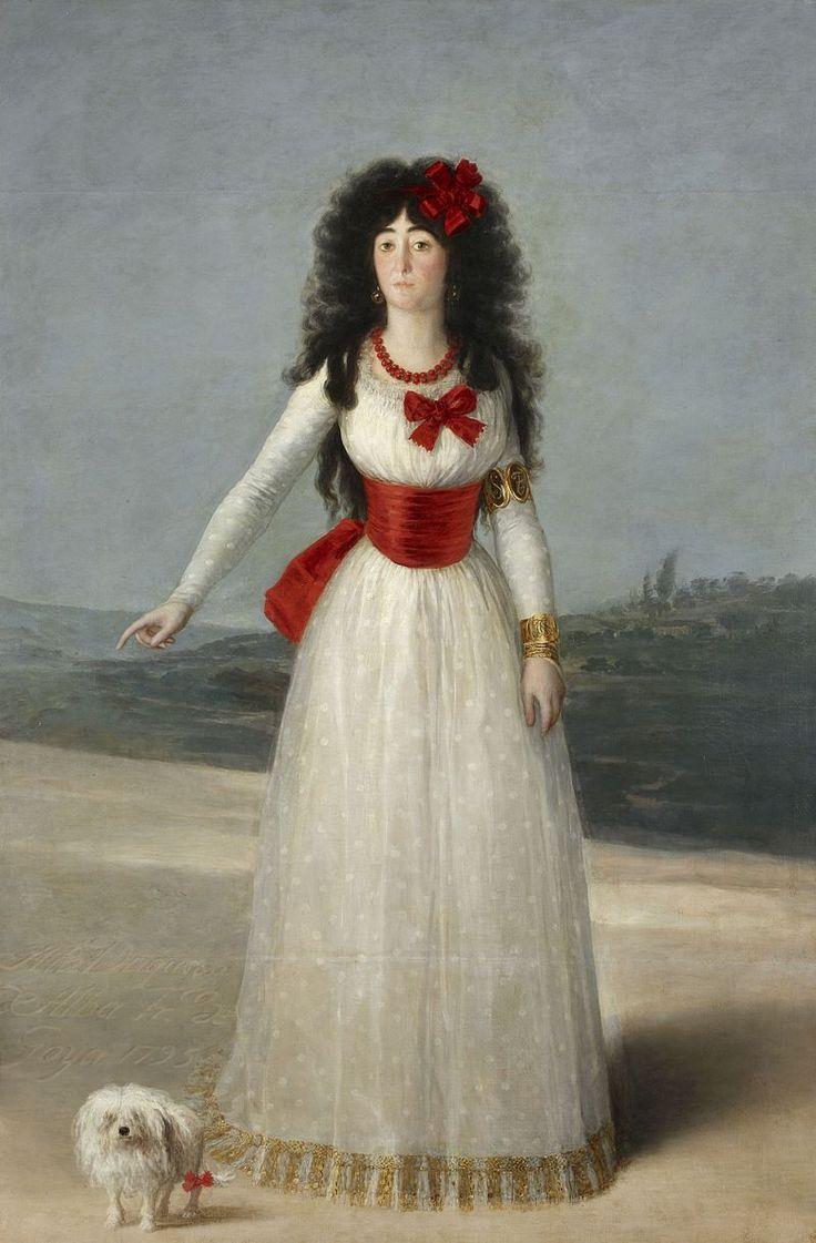 La Duquesa de Alba. 194 x 130 cm. Goya ha retratado a la Duquesa ataviada con un elegante vestido de gasa blanca, adornado con una cinta roja en la cintura y varios lazos del mismo color en la pechera y en el pelo y un collar. La acompaña un perrillo faldero que simboliza la fidelidad, posiblemente la que le profesaba el mismo pintor. La belleza de la dama es perfectamente interpretada por el aragonés, aunque debamos considerar diferente el canon de belleza del siglo XVIII al actual.
