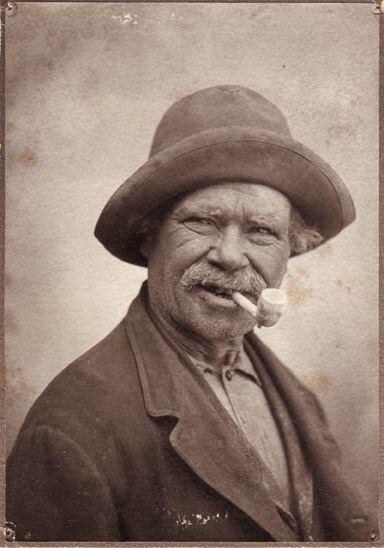 Man smoking clay pipe