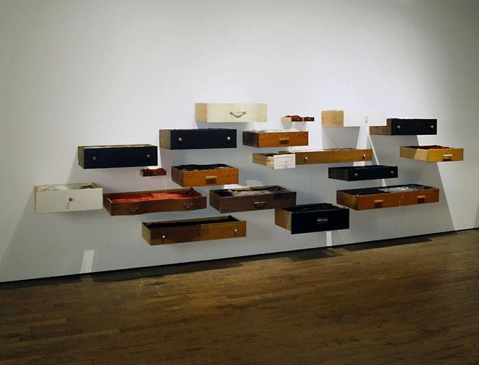 Artist:Anne Lindberg behold  found wooden drawers, rayon thread.2005 16 by 7 by 3 feet, variable