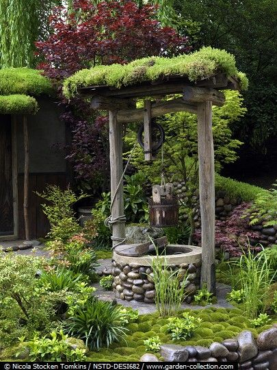 Moss covered wishing well. Would love one in my garden