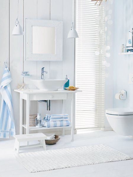 This bathroom gets its seaside style using the colors of light blue and white.