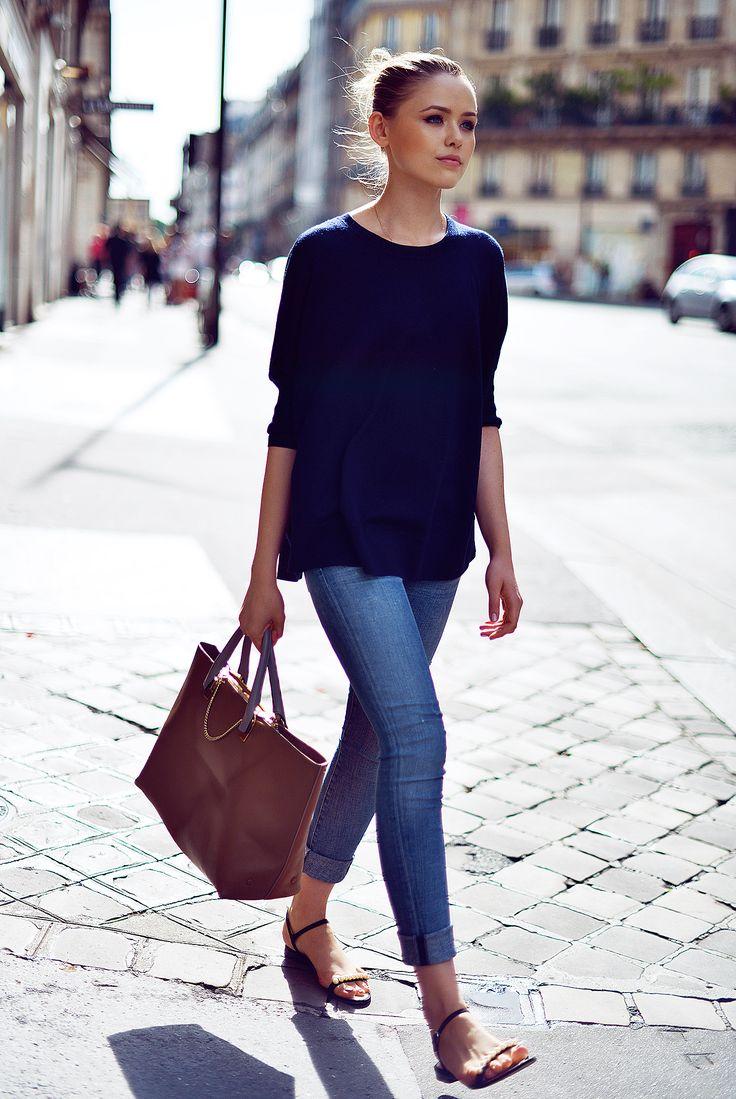 navy top, skinny jeans, flat sandals -- effortless street style