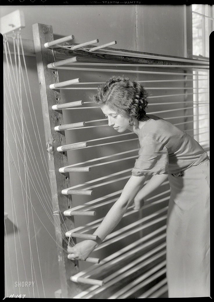 "Lewis Wickes Hine: photographer | Gatlinburg, Tennessee, U.S.A. | 1933 | ""Beulah Ogle preparing warp for weaving at the Pi Beta Phi School. She is a new weaver at the school and lives on a mountain farm."""
