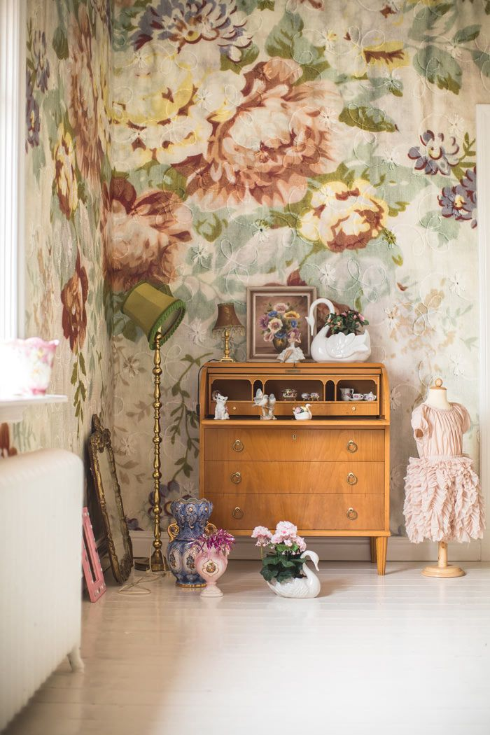Scandinavian Styling in a Swedish Homestead | Design*Sponge. The huge floral wallpaper print...