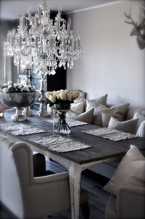 Contemporary Dining Room with Woodland Imports Beautiful Deer Head Wall Decor, Crown molding, Hardwood floors, Chandelier