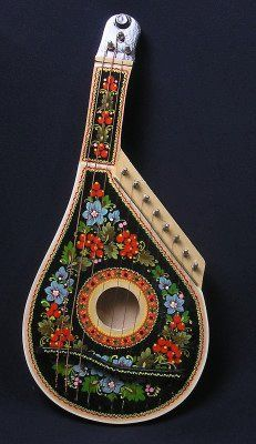 Bandura, a Ukrainian plucked string folk instrument. It combines elements from the zither and lute, as was based on its lute-like predecessor, the kobza. It typically has 12 to 68 strings. - wikipedia