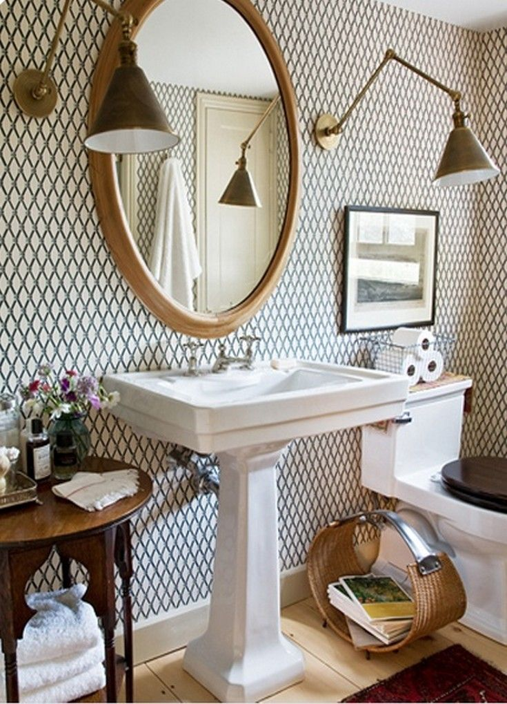 Love the wallpaper and the antique table next to the sink