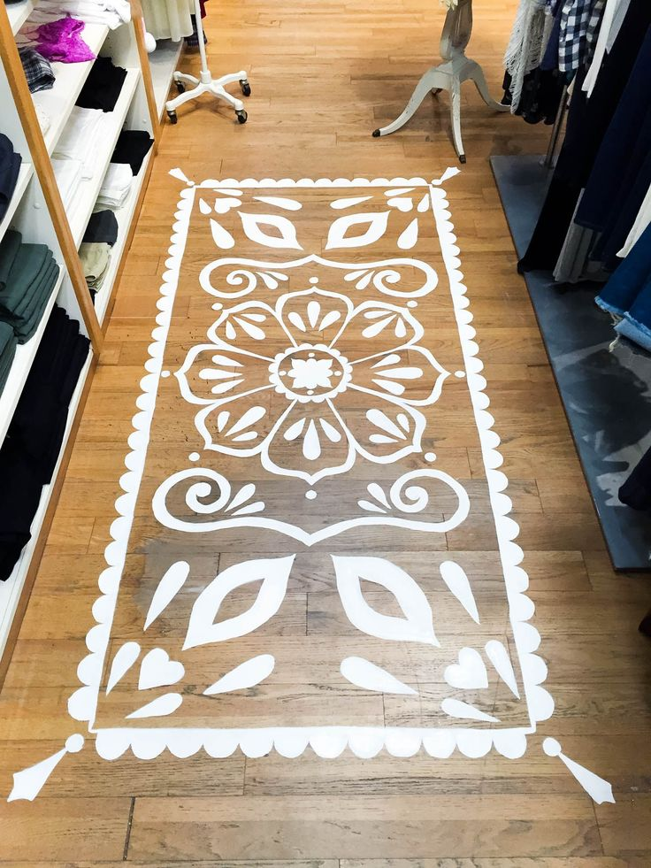 """How to paint a """"rug"""" onto a wood floor. (She did this to cover a water stain!) Mandala Floor Painting at Ooh La Loft by Katie Harvey"""