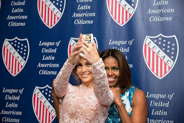 First Lady Michelle Obama and Jennifer Lopez pose for a selfie before the 85th Annual League of United Latin American Citizens (LULAC) National Convention and Exposition in New York, N.Y., July 10, 2014. (Official White House Photo by Amanda Lucidon)