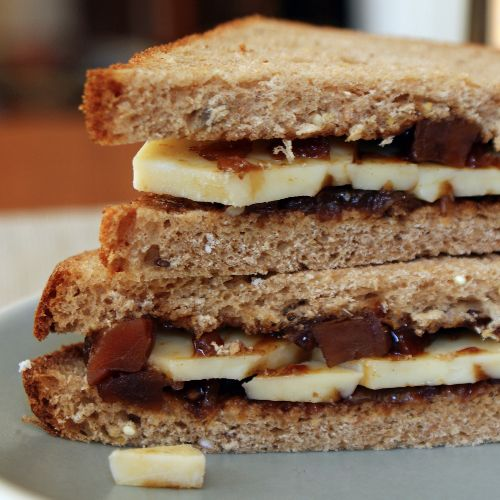 Cheese and Pickle Sandwich: consists of slices of cheese (typically Cheddar) and pickle (a sweet, vinegary chutney with the most popular brand being Branston), sandwiched between two slices of bread. The inside slices of the bread may be buttered with butter or margarine, and the sandwich may include salad items such as lettuce. A popular sandwich, especially in pubs.