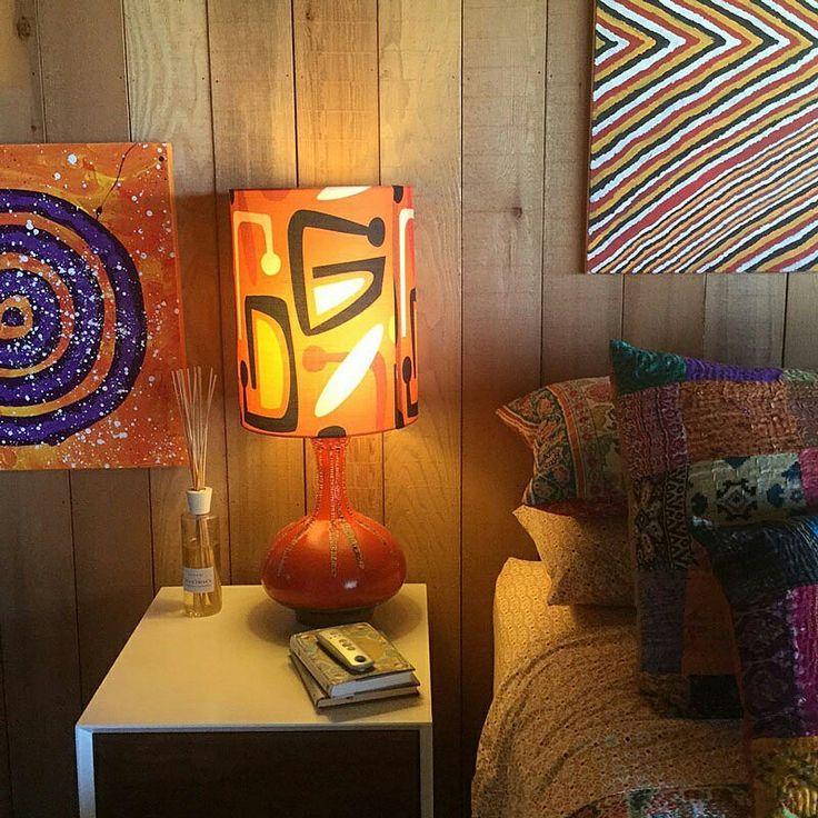 GLOW ZONE Lampshade of our #waikikicitrus #fabric casts a warm glow over an eclectic mix of #pattern. See all our ranges online @socialfabric.com.au #upholsteryfabric #lampshadefabric #furnishingfabric #draperyfabric #waikiki #retrofabrics #midcenturymodern #lampshade #TextileDesigner #LynneTanner #madeinaustralia