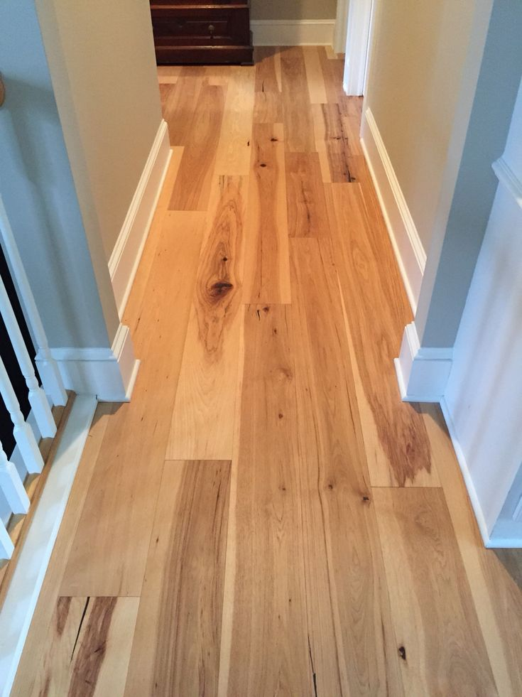 Natural hickory wide plank floors