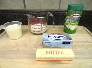 Homemade Creamy Alfredo Sauce - I have changed the recipe I cook at home by substituting some or all of the butter with EVOO, and the sauce still tastes amazing!!!  You can also use Neuftchel.  This recipe also reheats well; might need to add a few tablespoons of water if it does not reheat as creamy as you would like it.
