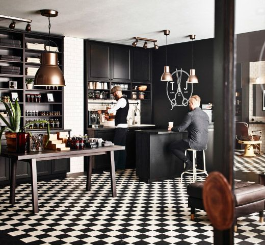 A Hairdressing Saloon Furnished With Black Brown Kitchen Cabinets