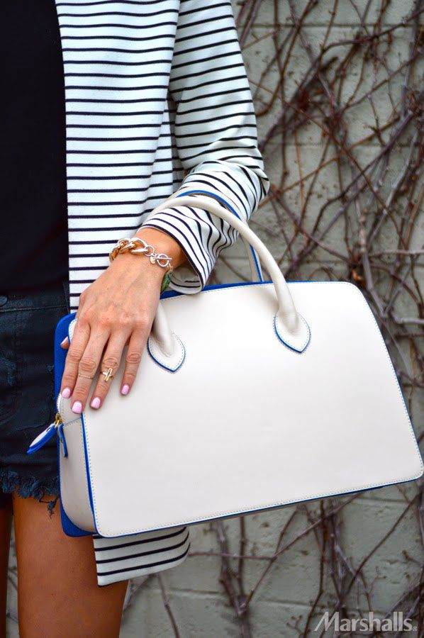 Every neutral loves a pop of color. This structured handbag (with cobalt-blue piping!) will be a standout all spring.