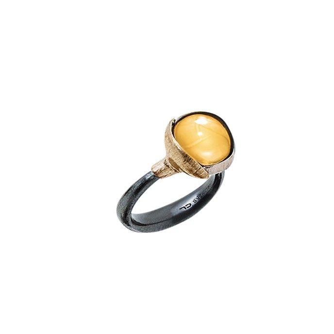 Lotus ring i sølv og guld med rav