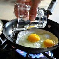 Make basted eggs: the easier, just-as-delicious version of poached eggs. Basted eggs are like steamed fried eggs. You cook them by cracking them into the pan as if you're going to fry them, but instead, you add some water, cover the pan, and you end up with perfectly runny and scrumptious eggs