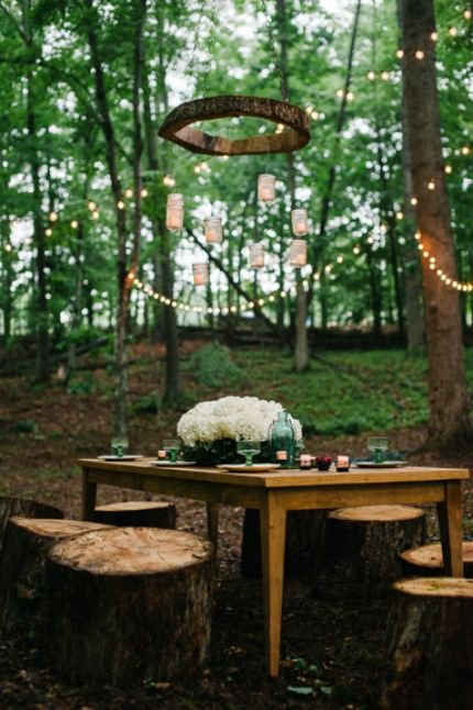 Hanging lights and other decorative pieces from trees or outdoor beams adds a rich element of depth to any outdoor soiree. #Daphnia #DinnerParty