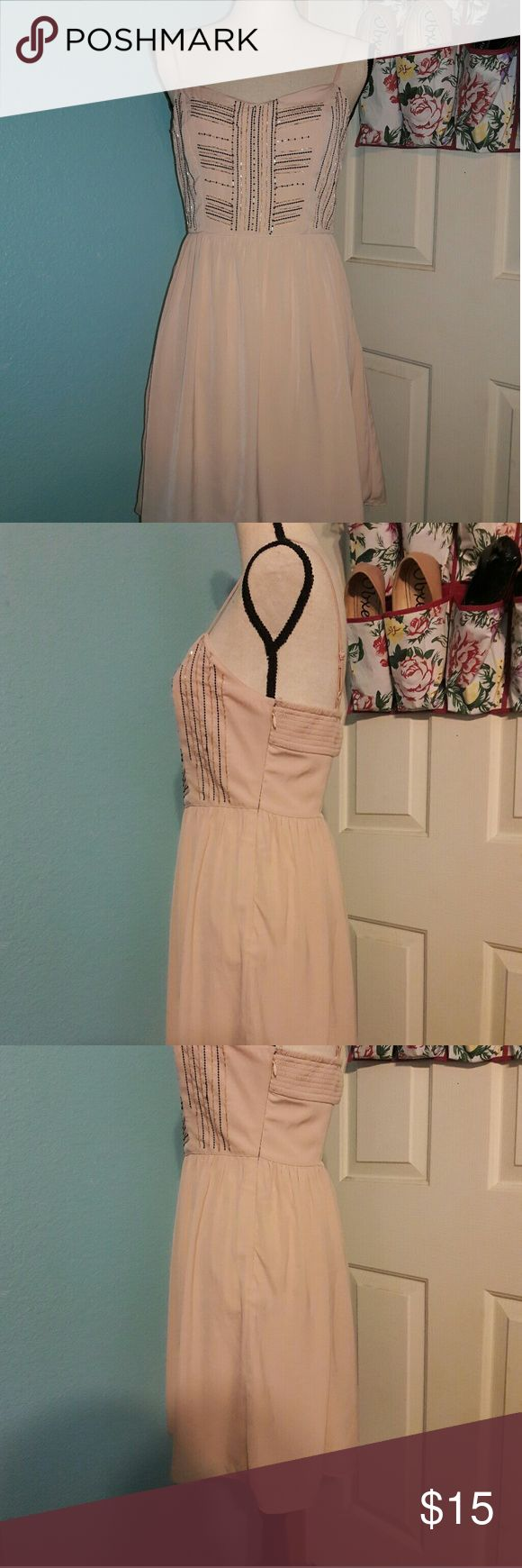 Cute Pink American Eagle Outfitters Dress This is a cute pink dress, perfect for summer. It looks in very good condition. Does have some flaws shown in the last 3 pictures. Even though there's those flaws I don't think you'll be able to tell unless you stare  to try to look for then then that's when you're able to tell. American Eagle Outfitters Dresses Mini