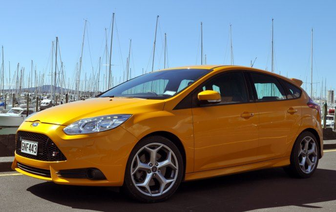 The 2013 Ford Focus ST in yellow is quite conspicuous. And it should be, because with 250hp and a mountain of torque from its 4-cylinder turbocharged engine, you'll want people to know you mean business. The Recaro seats hug you like a favourite aunty, and it'll grip the road like its one with the tarmac. #FocusST #Ford #review
