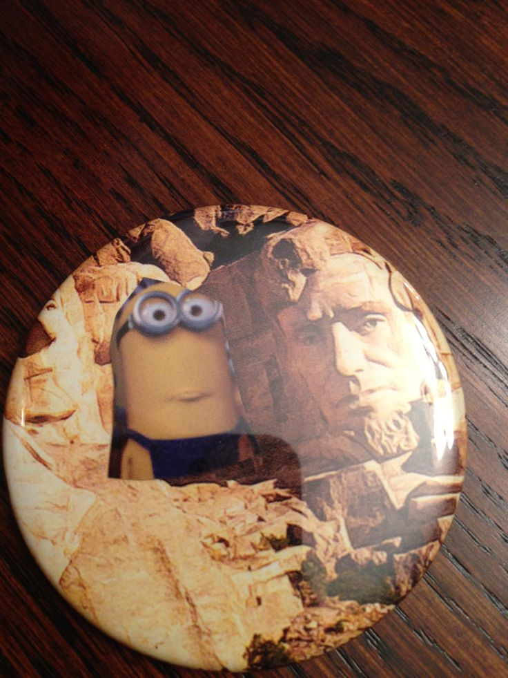 Minion and Abe hanging out Mr. Rushmore style.   One of my faves.   2.25 inch Pinback button